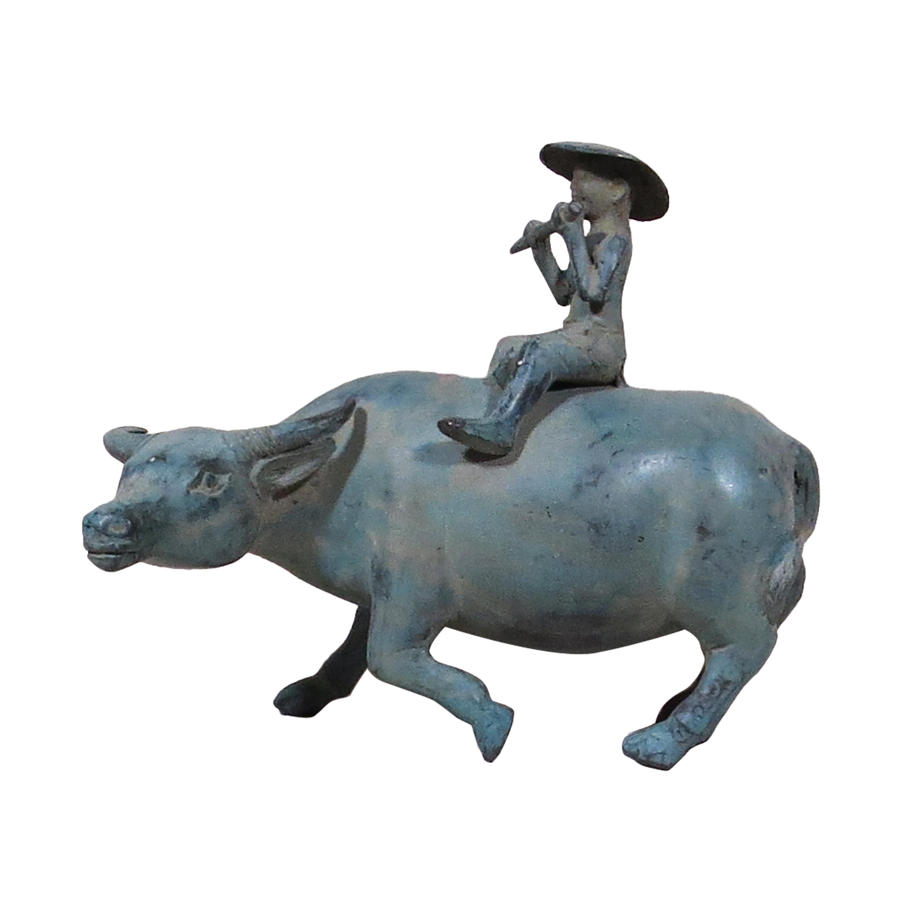 Búfalo de agua con sembrador