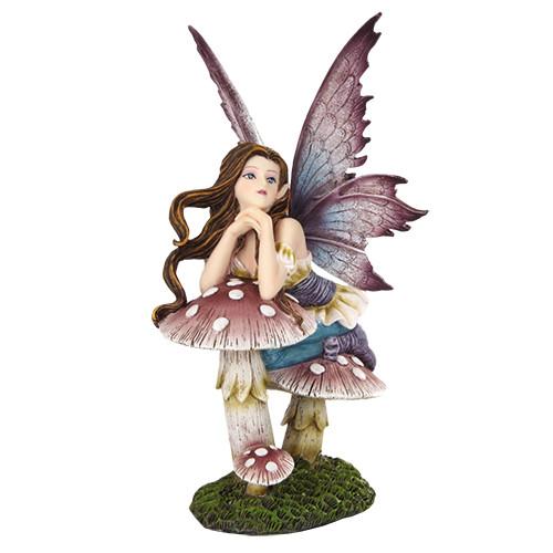 Hada Fairyland Apoyada en Hongo