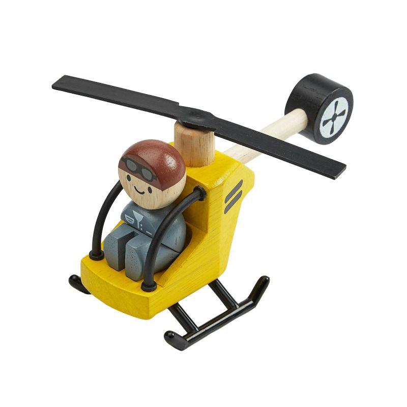 Helicóptero con piloto de madera