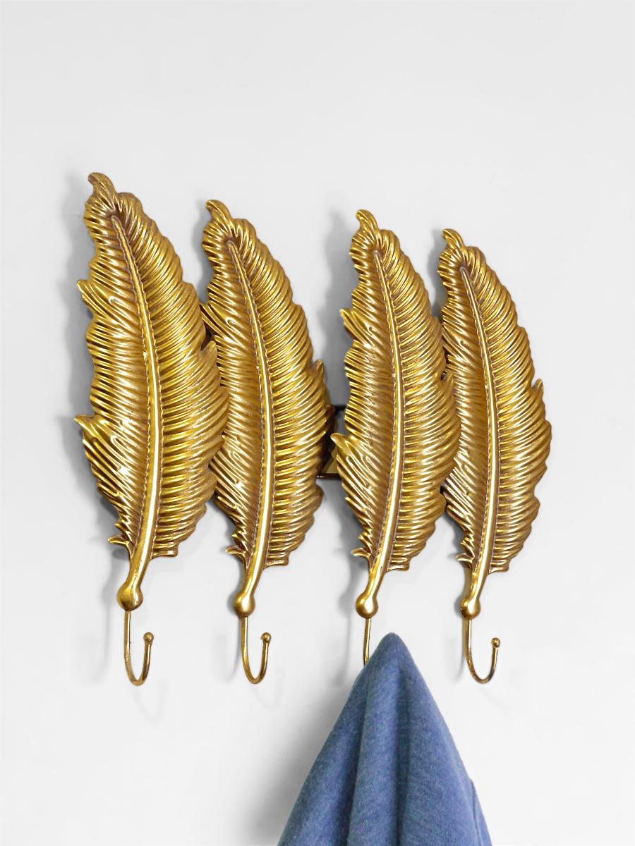 Perchero plumas dorado