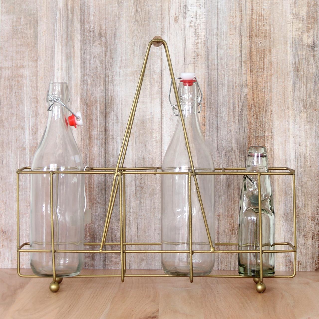 Porta botellas dorado
