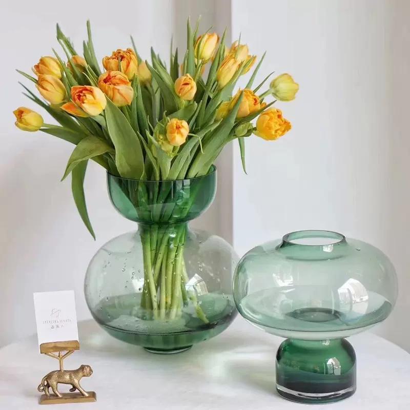 Floreros vidrio verdes